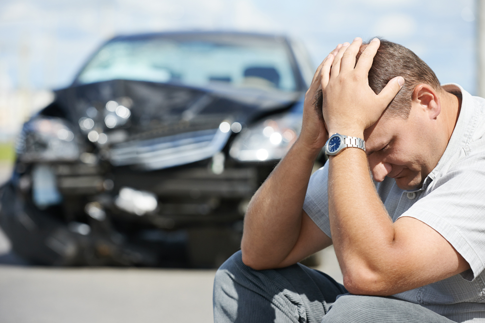 man stressed because his car is totaled